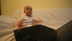 Baby child playing with a computer Stock Footage