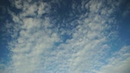 Time-lapse of beautiful white clouds moving over blue sky Stock Footage