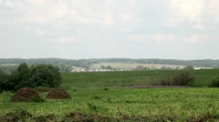 behind a field small village - stock footage