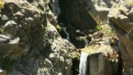 Stock Video Footage of People rappelling down a waterfall 5