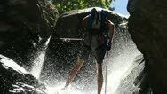 Stock Video Footage of People rappelling down a waterfall 24