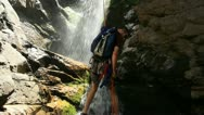 Stock Video Footage of People rappelling down a waterfall 26