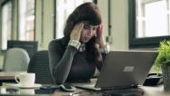Stock Video Footage of Young attractive businesswoman having headache in the office HD
