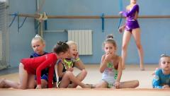 Girls gymnasts having training in gym before examination in school of gymnastics - stock footage
