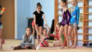 Girls gymnasts having training in gym before examination in school of gymnastics Stock Footage