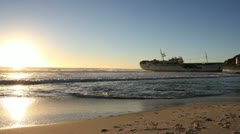 Ship stranded in Clifton beach at Sunse - stock footage