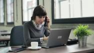 Young attractive businesswoman talking on telephone in the office HD Stock Footage