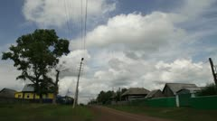 the cloudy sky over the village - stock footage