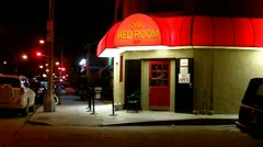 Men Leaving Tavern At Night Stock Footage