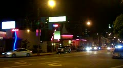 Night Traffic On Downtown Street With Restaurants Stock Footage