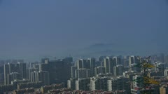 Panoramic of high-voltage wire tower in urban city,building house,distant mount Stock Footage
