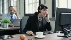 Friendly happy female helpdesk consultant in the office HD Stock Footage