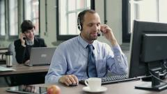 Friendly happy male helpdesk consultant in the office HD - stock footage