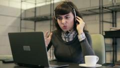 Angry female helpdesk consultant in the office HD - stock footage