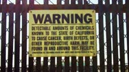 Stock Video Footage of Hazardous Chemicals Warning Sign At Oil Refinery Zoom
