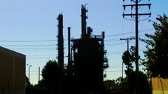 Oil Refining Tower And Electric Power Lines Silhouette Stock Footage