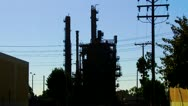 Stock Video Footage of Oil Refining Tower And Electric Power Lines Silhouette