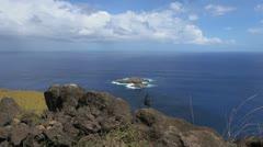 Easter Island Orongo bird islands from rocky overlook 2b Stock Footage