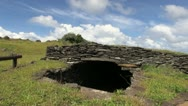 Easter Island Orongo entrance to round house 2a Stock Footage