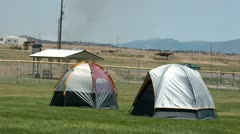 Fire fighters sleeping tent with smoke in background P HD 0664 Stock Footage