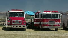 Fire trucks and firemen resting from fighting wildfire P HD 0644 Stock Footage