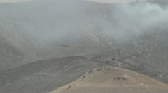 Helicopter Scouting Fire - stock footage