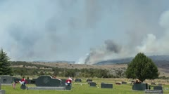 Wildfire approached cemetery in rural Fairview Utah P HD 0676 Stock Footage