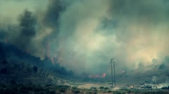 Firefighters fighting raging fire - stock footage