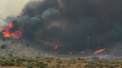 Firefighters Battling Huge Wildfire - stock footage