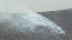 Fire Burning on Mountainside Stock Footage