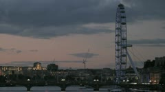 The iconic London Eye and Waterloo Bridge at dusk. Stock Footage