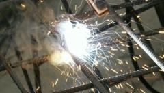 Soldering Steel Rods with Sparks (HD) - stock footage