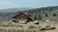 Fire fighters protect home on edge of wildfire P HD 0591 Stock Footage