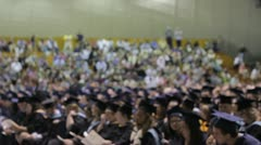 Stock Footage - Slightly out of focus group at college graduation - w/crowd Stock Footage