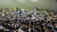 Stock Video Footage of Stock Footage - Slightly out of focus group at college graduation - w/crowd