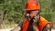 Stock Video Footage of Construction Engineer Talking on the Phone, Worker Speaking on the Phone