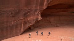 Walking hiking through red rock canyon. Western U.S. Hikes, Canyons, Deserts - stock footage
