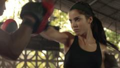 Woman exercising with trainer at boxing and self-defense lesson Stock Footage