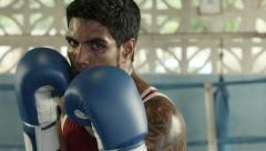 Portrait of caucasian boxer on ring looking at camera Stock Footage