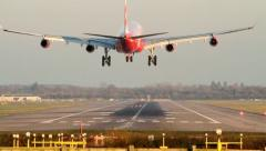 Plane Landing on Runway Stock Footage
