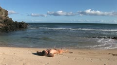Man rests on beach in beautiful Hawaii- time lapse. Stock Footage