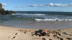 Man relaxes on gorgeous Hawaii beach Stock Footage