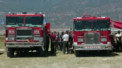 Fire trucks firemen brief for forest fire attack P HD 0623 Stock Footage