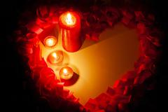 st. valentine's day greeting background with four burning candles - stock photo