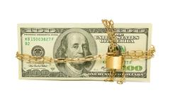 stack of us 100 dollar bills chained and locked - stock photo