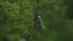 Telephone Lineman hooking up cable Stock Footage