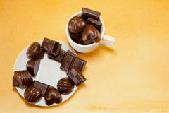 cup full with chocolate candies - stock photo