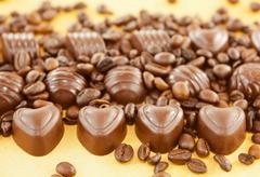 Heart shaped chocolate candies and coffee beans Stock Photos