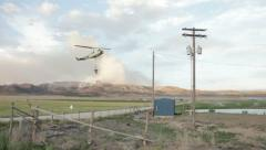 Wildfire helicopter dipping bucket in pond HD6742 Stock Footage