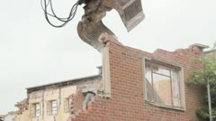 Pulling down derelict building - stock footage